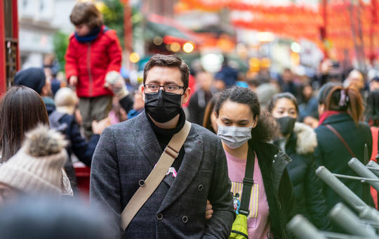 Crowd medical mask coronavirus istock powerofflowers